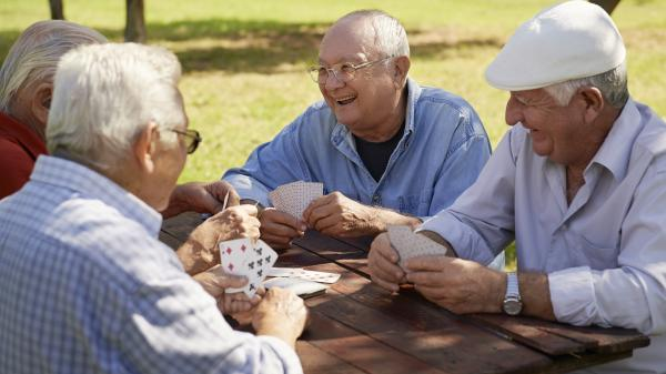 group of elderly men at park bench